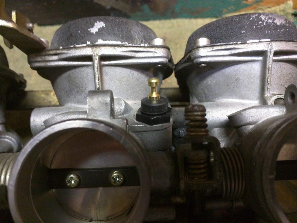 New choke valve and nut installed